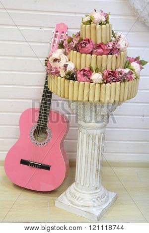 cake biscuit cookie decorated with flowers and a guitar