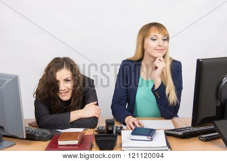 The Situation In The Office - One Girl Crazy Looks In The Picture, Her Colleague Looking At Monitor