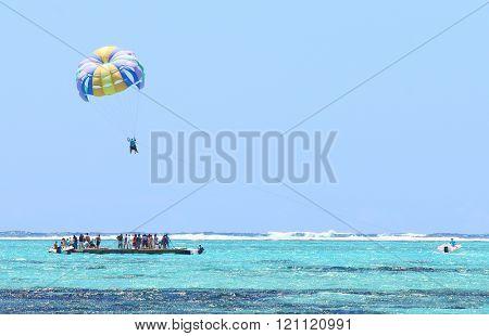 Parasailing over Indian Ocean near Mauritius Island.
