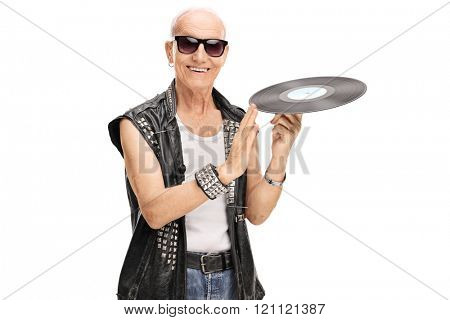 Senior punk rocker spinning a vinyl on his finger and looking at the camera isolated on white background