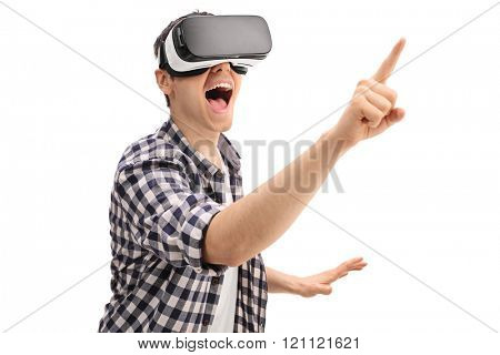 Excited guy using a VR headset and touching something isolated on white background