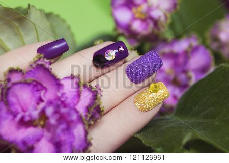 Manicures in the colors of violets.