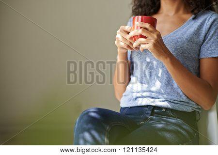 Enjoying hot beverage