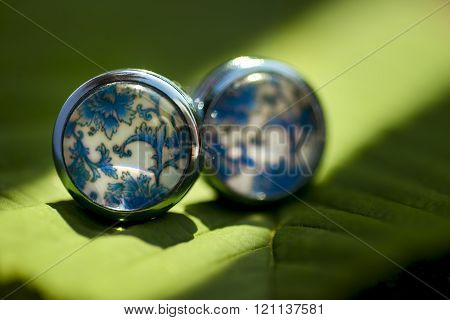 Beautiful cufflinks with blue shapes in natural light