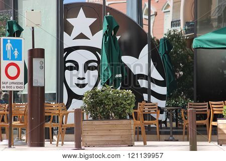 Terrace Of A Restaurant And Starbucks Mermaid Sign