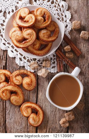 Coffee And Cookies Palmiers Close-up On The Table. Vertical Top View
