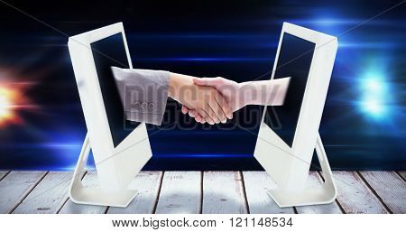 Handshake between two women against black background with spark