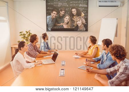 College students using computer against blackboard