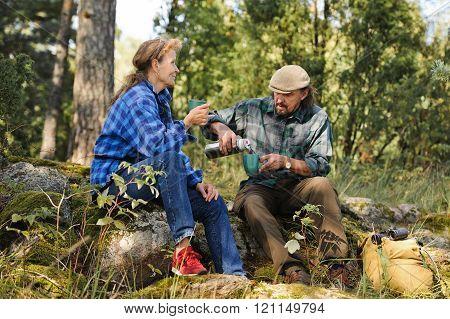 senior couple outdoors having a coffeee break