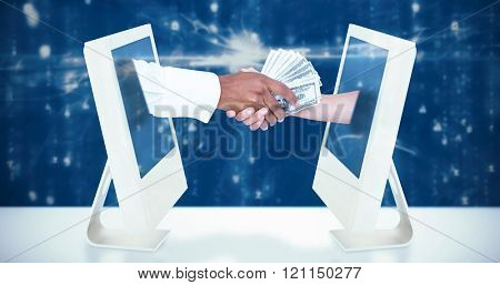 Businessman handing over banknotes to female colleague against digitally generated image of abstract pattern