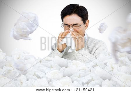 Smiling man using a tissue against used tissues