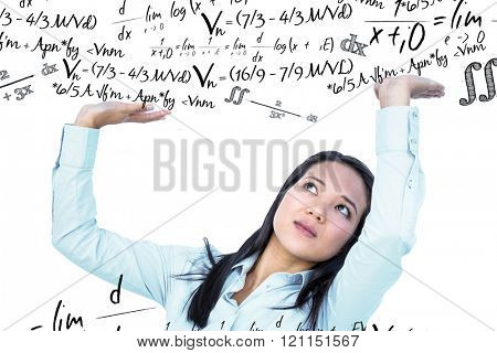 Worried businesswoman pushing something up against maths equation