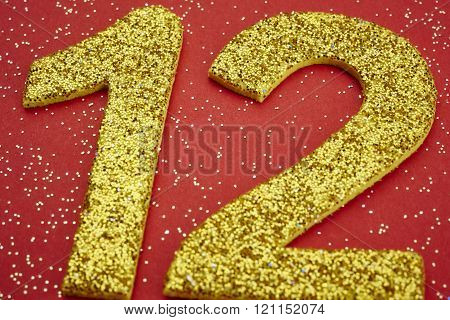 Number Twelve Yellow Color Over A Red Background. Anniversary