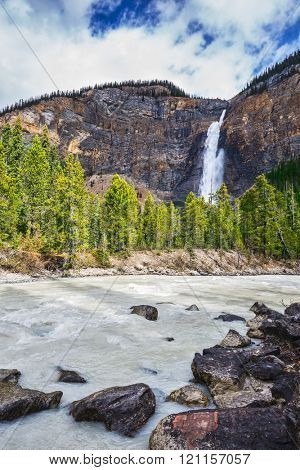 Grand Falls Takakkaw formed by melting glacier. Sunny autumn day in Yoho National Park