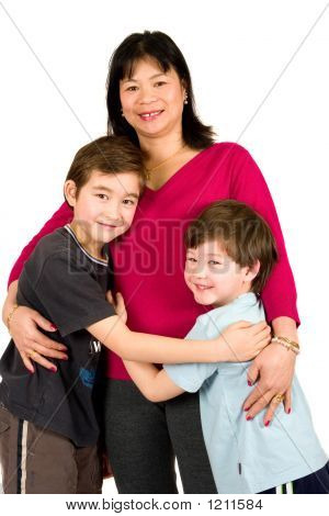 An Asian Lady With Her Two Beautiful Sons
