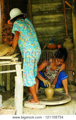 Workers making handmade ceramic creations