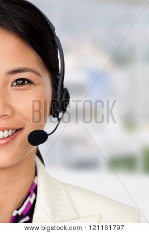 Radiant businesswoman using binoculars against office