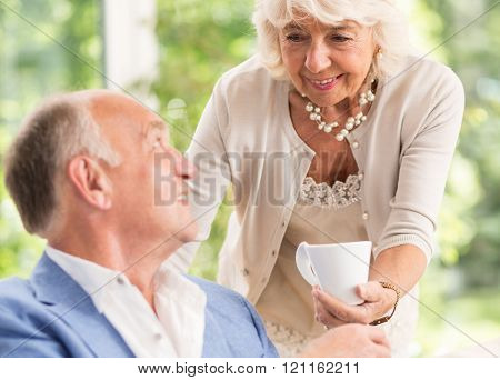 Devoted Wife Serving Coffee