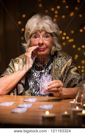 Eccentric Elderly Lady With Cards
