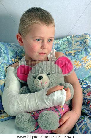 child with broken hand in plaster