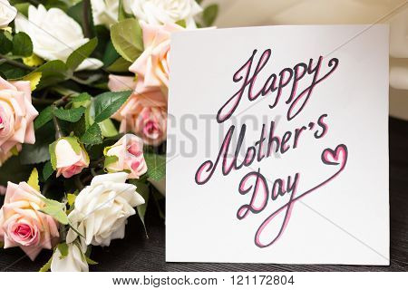 Mothers day handwritten card with rustic roses on wooden board