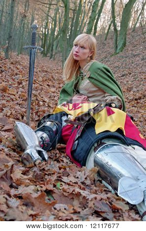 wounded knight and maid in forest