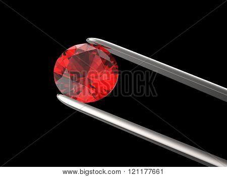 Round shape gemstone in the tweezers on dark background