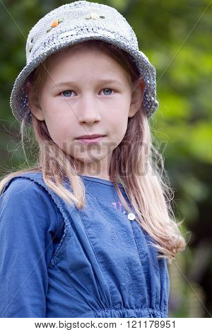 Little Girl In Blue Hat