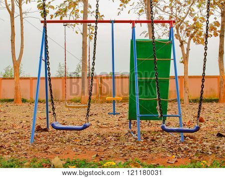The colorful swing set in the garden.