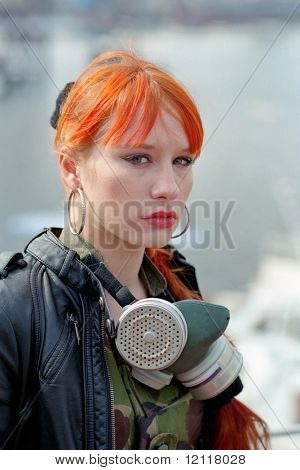 red hair woman with gas mask