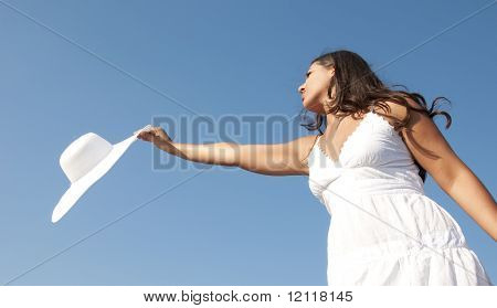 Girl in the blue sky with white hat