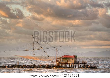 Traditional wooden buildings for fishing situated on the estuary of the River Arno Tuscany Italy.