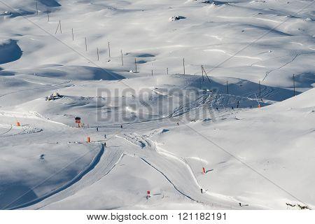 ZERMATT, SWITZERLAND - FEBRUARY 05, 2016: Ski runs cross over on Gornergrat above Zermatt in Switzerland