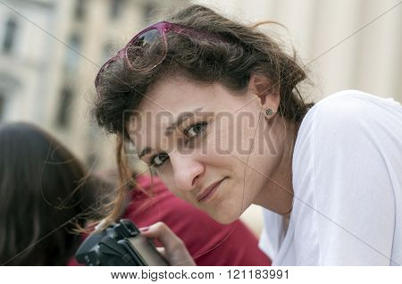 Woman photographer looking at camera and posing