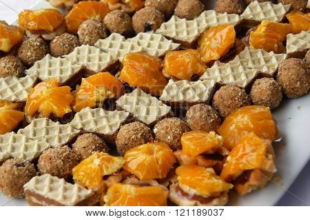 Variety of different sweets laid out on a plate