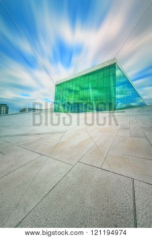 OSLO, NORWAY - AUGUST, 2014: The Oslo Opera House in Norway. The angled exterior surfaces of the building are covered with white granite and make it appear to rise from the water.
