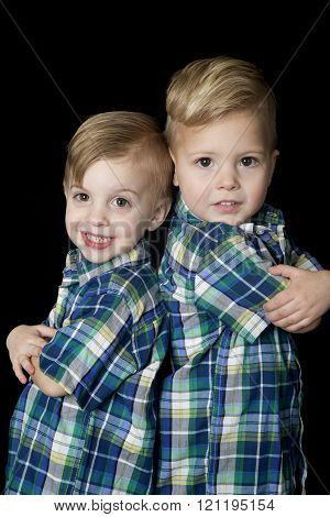 Young Blond Boys Arms Folded Back To Back Cute Attitude
