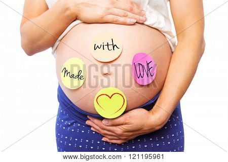 Pregnant woman with stickers on bump against made with love message