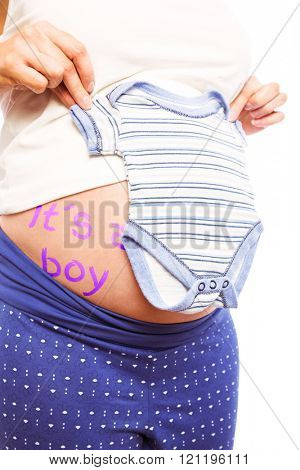Pregnant woman holding blue pyjamas over her belly