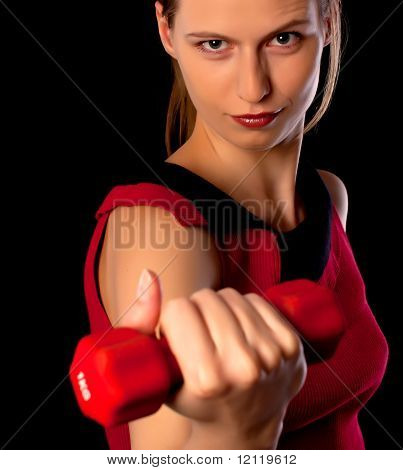 Serious Woman Athlete Showing Dumbbell