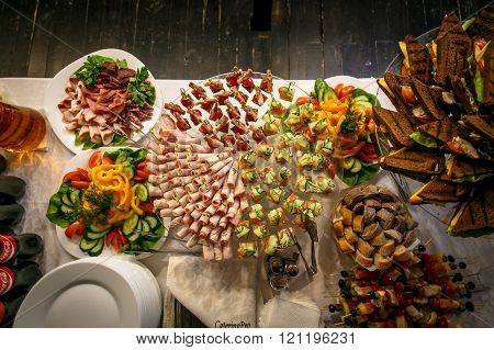 Top view of catering services background with snacks on guests table in restaurant at event party.
