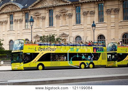 Yellow city sightseeing bus Neoplan on Paris city street.