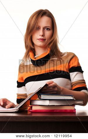 Young Teacher Woman Sitting At The Desk