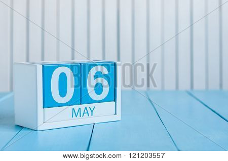 May 6th. Image of may 6 wooden color calendar on white background.  Spring day, empty space for text