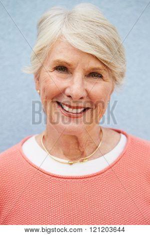 Senior Caucasian woman, vertical head and shoulders portrait