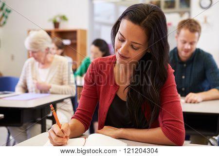 Hispanic woman studying at an adult education class