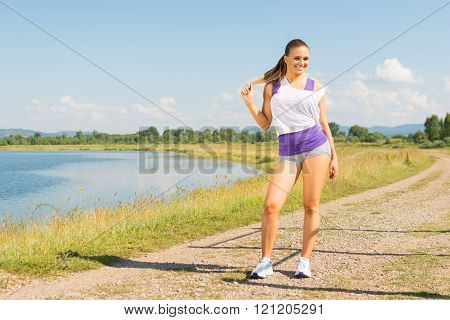 Young fit runner woman outdoors in summer