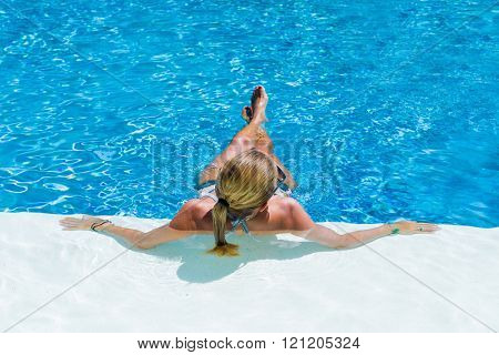 WOman sunbathing at the swimming pool