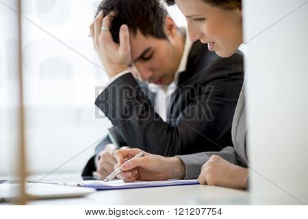 Business Colleagues, Man And Woman, Working At Office Desk