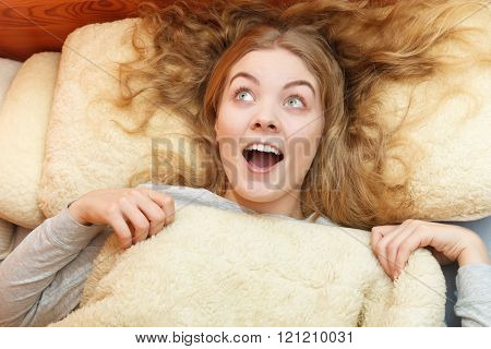 Woman Waking Up In Bed In Morning After Sleeping